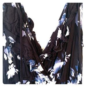 Black romper with white and blue flowers